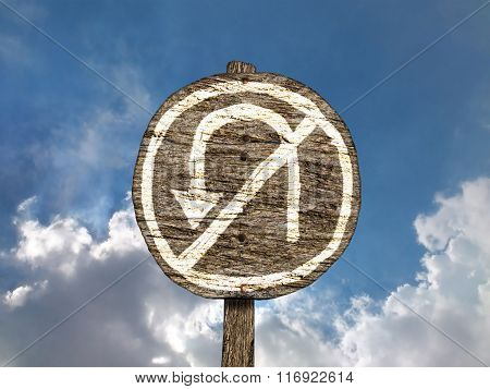Crude Hand-painted No U-Turn Sign on Old, Wooden Signpost
