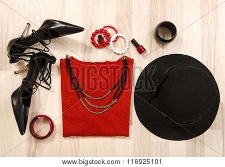 Winter Sweater With Accessories Arranged On The Floor.