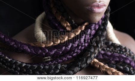 afro-american woman with colored long braids