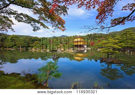 Golden Pavilion or Kinkakuji Temple with autumn leaves in Kyoto Japan
