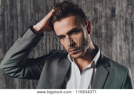 Attractive Rigid Man In Business Suit On The Grey Background