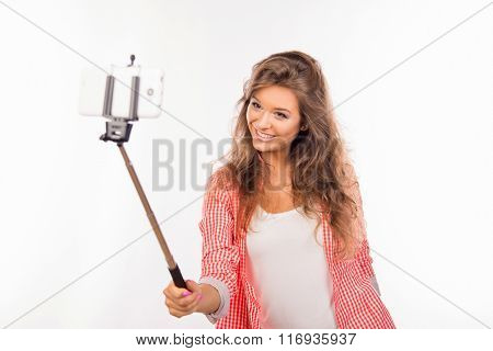 Happy Nice-looking Young Woman  Making Selfie Photo With Stick