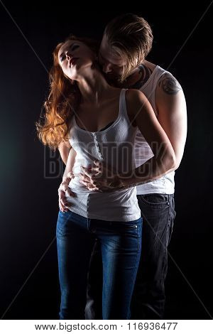 Sexual woman with red hair and kissing man