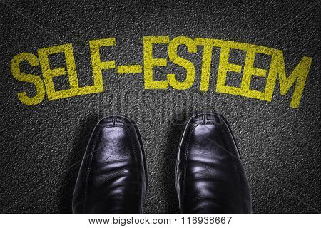 Top View of Business Shoes on the floor with the text: Self-Esteem