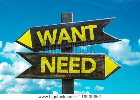 Want - Need signpost with sky background