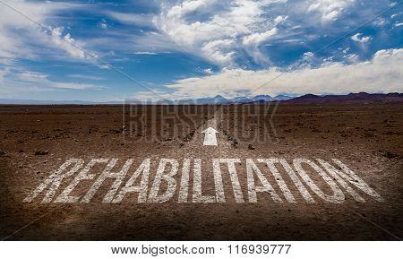 Rehabilitation written on desert road