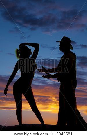 Silhouette Of A Woman In A Bikini Hips To Side Hand Over Head Cowboy