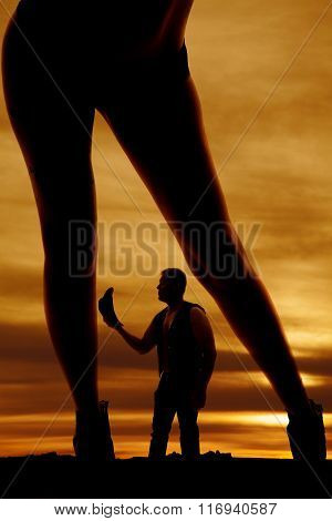 Silhouette Of A Woman In Bikini Bottoms Legs Lean To Side Over Cowboy