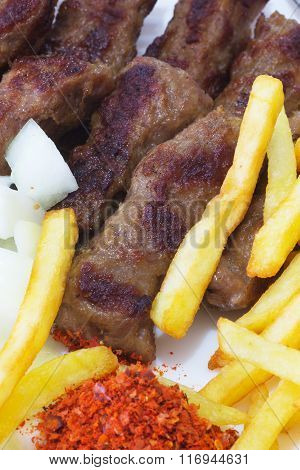 Cevapi - Traditional Food of the Balkans. Minced Meat Cooked on the Barbecue with Fresh Onion. poster
