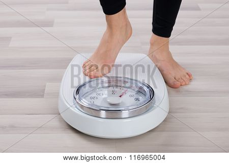 Person Standing On Weighing Scale