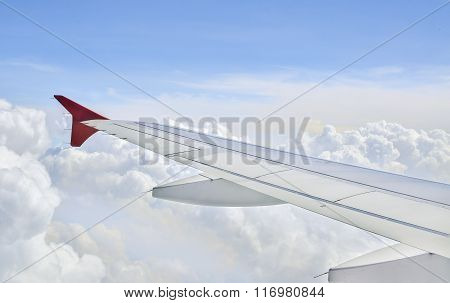 Wing of an airplane in cloudy