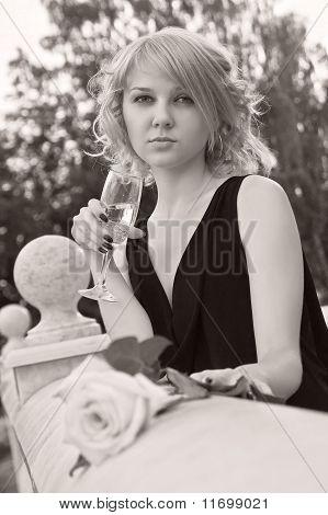 Beautiful Woman Drinking Champagne From Wineglass
