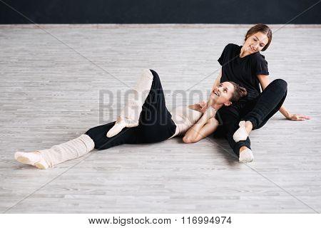two dancers friends practice in dance studio