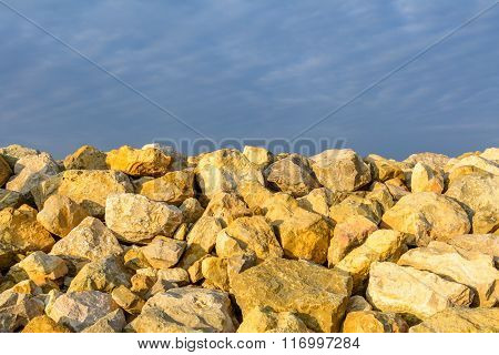 Sky And Several Yellow Rocks. Backgroung With Clear Blue Sky Meeting Multitude Of Yellow Rocks On Da