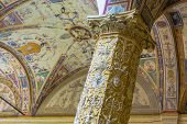 Detail of a decorated column and ceiling in the Palazzo della Signoria first Courtyard poster