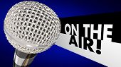 On the Air words beside a 3d microphone to illustrate a live program or broadcast talk show on TV or radio or a podcast online or streaming poster