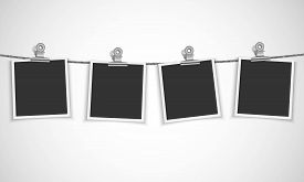 Blank photo frame hanging on a rope