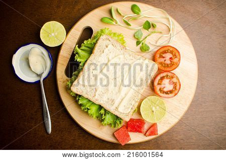 Breakfast, whole wheat bread with cream and vegetables