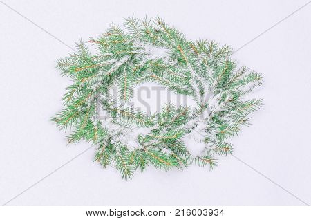 Snowy Frosted Christmas Wreath. Wreath Of Fir Branches On Snow.