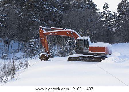 Chushevitsy, Verkhovazhsky District, Vologda region, Russia - January 22, 2016: Frozen excavator near the forest road