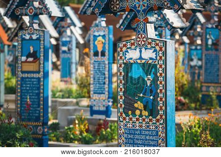 Sapanta,romania - 04 July, 2015- Carved And Painted Wooden Crosses In The Merry Cemetery In Sapanta,