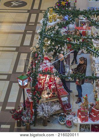 Czech Republic, Prague, Palladium Shopping Centre, November 23, 2017: Man And Woman And Girl Shoppin