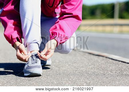 Minsk, Belarus - July 25, 2017 : Woman walking with Adidas shoes Illustrative editorial