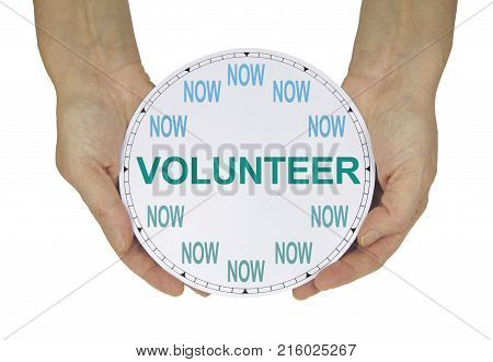 Please volunteer NOW  - female hands holding a clock with no hands that has NOW in place of the numerals and VOLUNTEER instead of hands isolated on a white background