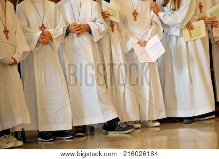 Children With White Tunic During The Religious Rite Of The First
