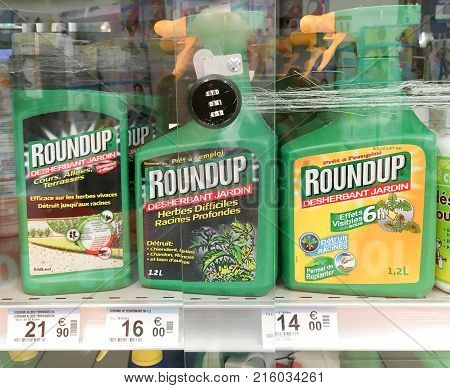 Paris France - November 11 2017: Shelves with a variety of Herbicides in a french Hypermarket. Roundup is a brand-name of an herbicide containing glyphosate made by Monsanto Company.
