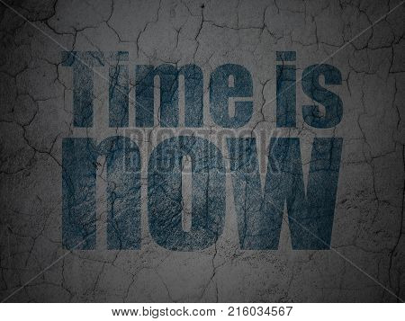 Time concept: Blue Time is Now on grunge textured concrete wall background