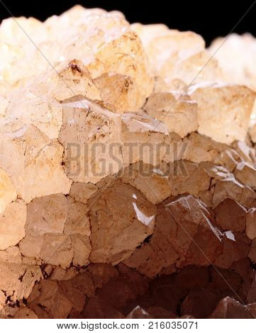 Closeup photograph of quartz stone lit from above on a black background. Natural phenomenon.