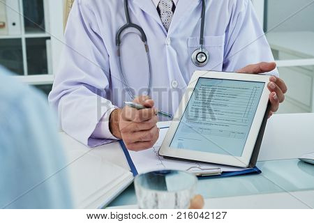 Doctor asking patient to fill the survey before medical treatment