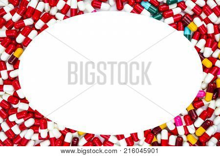 Colorful of antibiotics capsule pills oval frame on white background with copy space. Drug resistance concept. Antibiotics drug use with reasonable and global healthcare concept.