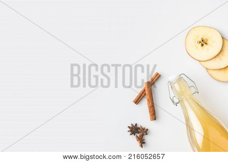 top view of apple cider composition with cinnamon sticks isolated on white