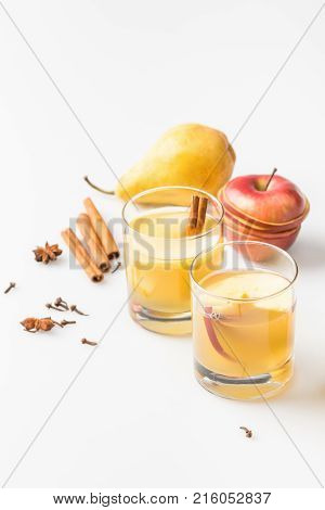 glasses of delicious spiced cider with pear and apple