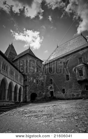 Empty misterious courtyard of an old stone castle