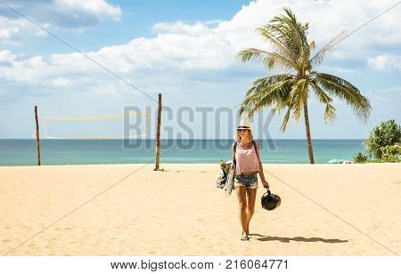 Young woman traveler walking on the beach at island hopping in Phuket - Wanderlust and travel concept with adventure girl tourist wanderer on day excursion in Thailand - Bright warm afternoon filter