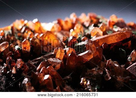Brown transparent quartz natural crystals with glittering peaks on a gray background. Natural phenomenon.