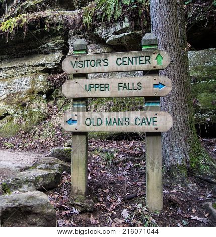 Hiking In Hocking Hills State Park. Directional sign on trail in the Old Mans Cave area of Hocking Hills in Ohio. Hocking Hills is a popular Ohio landmark and is beloved by outdoor enthusiasts for its rugged terrain and scenery.
