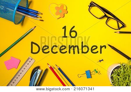 December 16th. Day 16 of december month. Calendar on yellow businessman workplace background. Winter time.