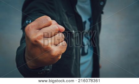 A man was fists clenched in anger