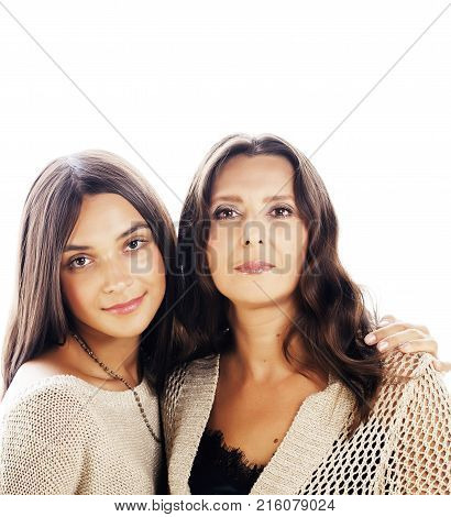 cute pretty teen daughter with mature mother happy hugging, fashion style brunette makeup close up tann mulattos, isolated on white background, lifestyle real people concept
