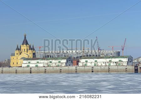 Nizhny Novgorod, Russia. - March 14.2017. The Cathedral of Alexander Nevsky. View with spring ice on the Oka in the foreground. The old stone warehouse on the river bank have not yet been destroyed.
