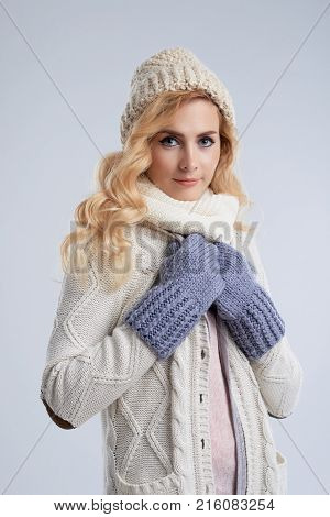 Pretty young woman wearing winter beanie and mittens