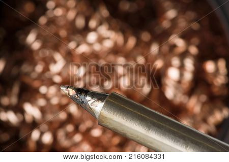 Metal chips in the tank is used to clean the soldering iron from the deposit