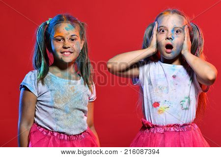 Girls With Confused And Happy Faces Stand On Red Background