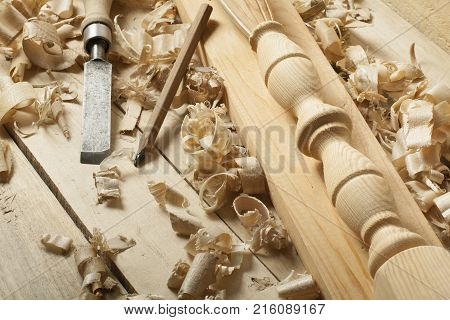 Carpentry concept.Joiner carpenter workplace. Old chisel, pencil and wooden workpiece on the table. Copy space for text. poster
