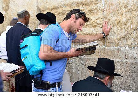 Jerusalem Israel - April 2017: An Tourist Jew Reads The Talmud Near The Western Wall. The Western Wa