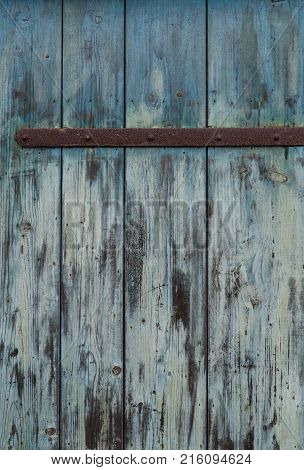 Turquoise wooden door retro vintage background structure.